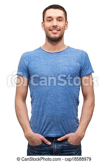smiling man in blank blue t-shirt - csp18588979