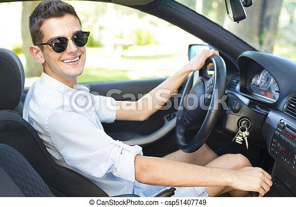 smiling man in car driving - csp51407749