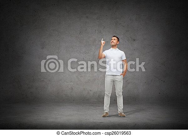 smiling man pointing finger up - csp26019563