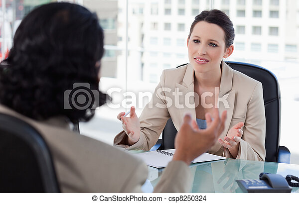 Smiling manager interviewing a male applicant - csp8250324