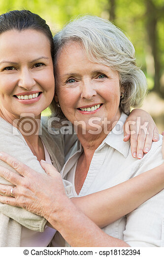 Smiling mature woman with adult daughter - csp18132394