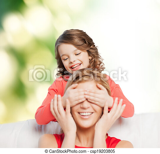 smiling mother and daughter making a joke - csp19203805