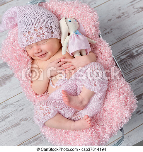 Smiling Newborn Baby Girl With A Toy Hare Cute Smiling Newborn Baby