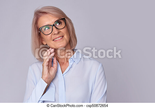 smiling old woman wearing glasses. Isolated - csp50872654