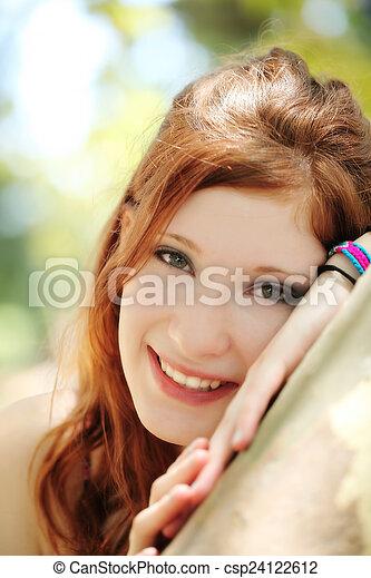 Smiling Outdoor Portrait Red Head Teen Girl - csp24122612