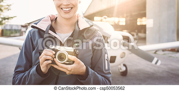 Smiling photographer at the airport - csp50053562