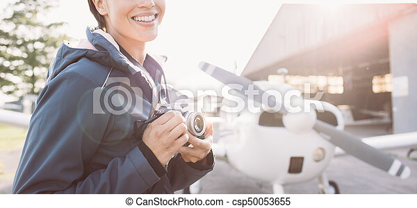Smiling photographer at the airport - csp50053655