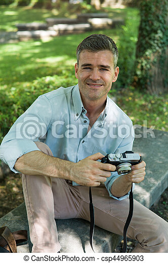 Smiling photographer at the park - csp44965903