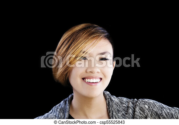 Smiling Portrait Attractive Asian American Woman On Black Background - csp55525843
