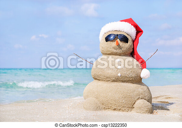 68fd861db67fd Smiling sandy snowman in red santa hat on the sea beach. holiday ...