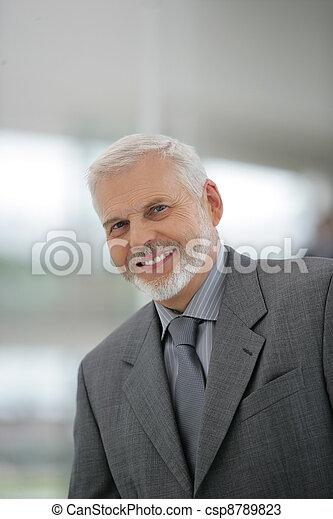 Smiling senior businessman - csp8789823