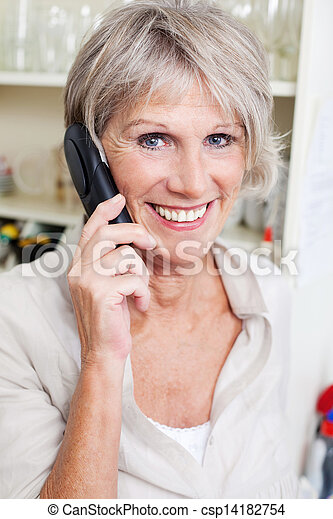Smiling senior lady talking on a telephone - csp14182754