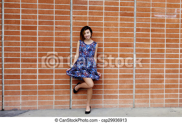 Smiling Skinny Asian American Woman Standing Outdoors - csp29936913