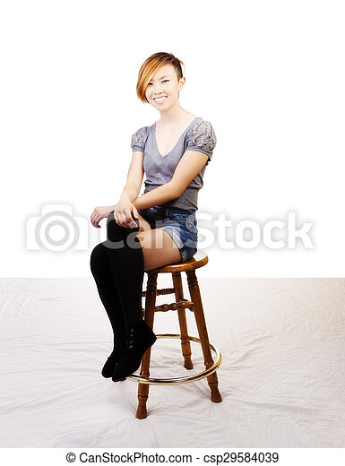 Smiling Skinny Attractive Asian American Woman Sitting - csp29584039
