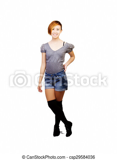 Smiling Standing Asian American Woman In Shorts - csp29584036