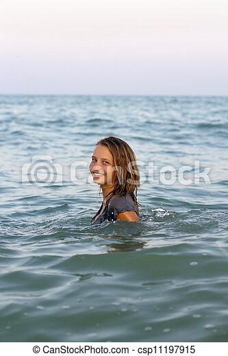 smiling teen girl in the sea - csp11197915