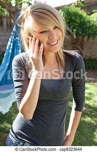 Smiling Teenager on Mobile Phone  - csp8323644