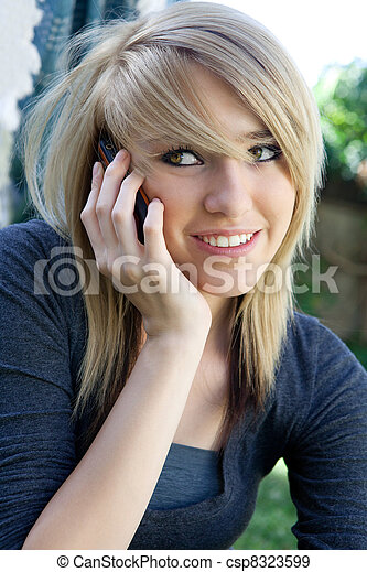Smiling Teenager on Mobile Phone  - csp8323599