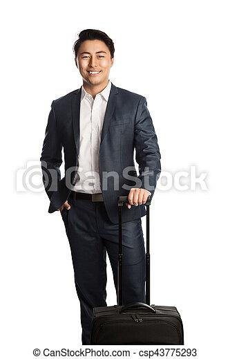 Smiling traveling businessman - csp43775293