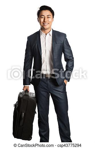 Smiling traveling businessman - csp43775294