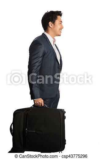 Smiling traveling businessman - csp43775296