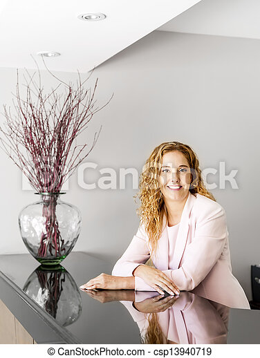 Smiling woman at office reception - csp13940719