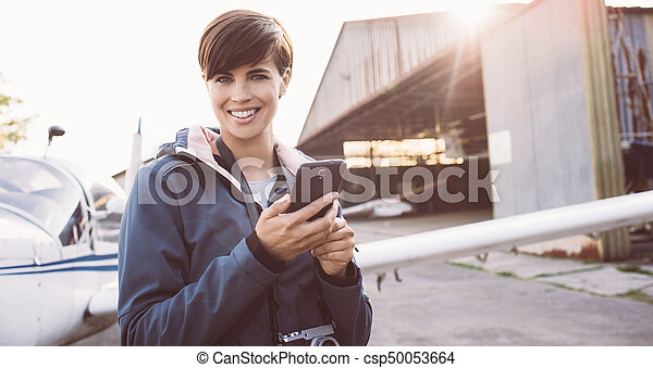 Smiling woman at the aerodrome - csp50053664