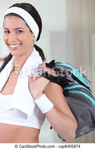 Smiling woman going to sports club - csp8405974
