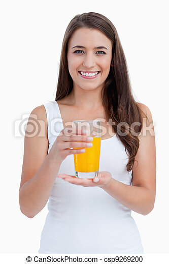 Smiling woman holding a glass of orange juice - csp9269200