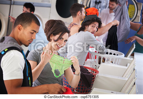 Smiling Woman Holding Underwear Csp6751305