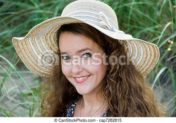 smiling woman in a summer hat - csp7282815