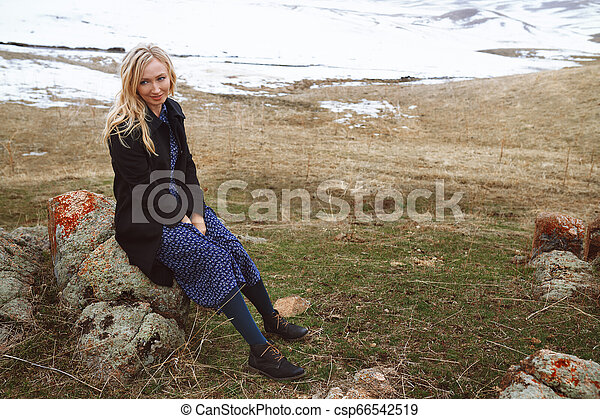 Smiling woman in the winter landscape - csp66542519