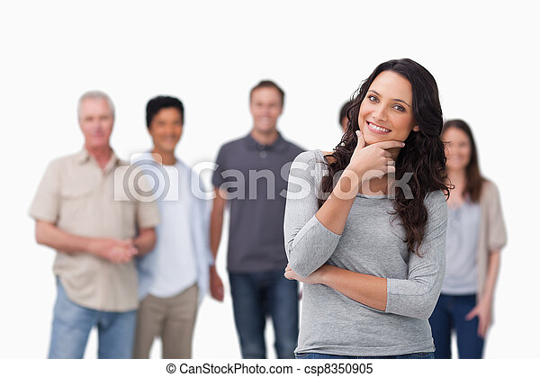 Smiling woman in thinkers pose and friends behind her - csp8350905
