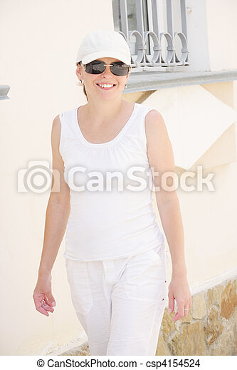 Smiling woman in white - csp4154524