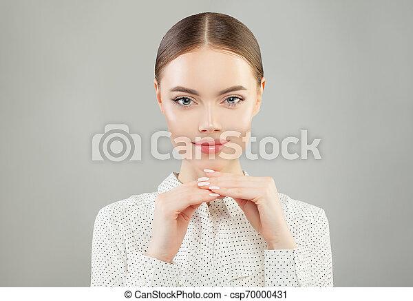 Smiling woman on white background portrait - csp70000431