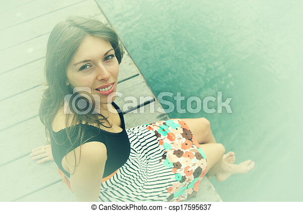 smiling woman outdoors - csp17595637