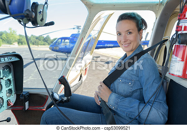 Smiling Woman Pilot Inside Helicopter Cockpit