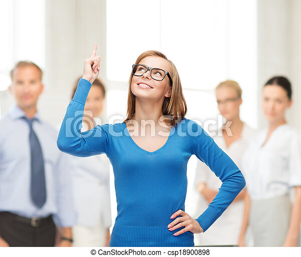 smiling woman pointing her finger up - csp18900898