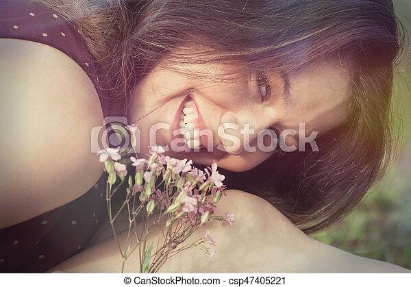 smiling woman portrait outdoor closeup - csp47405221