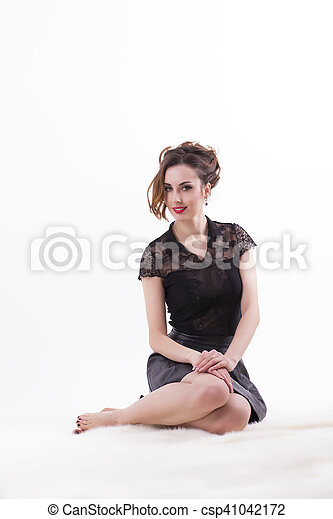 Smiling woman sitting on white background - csp41042172