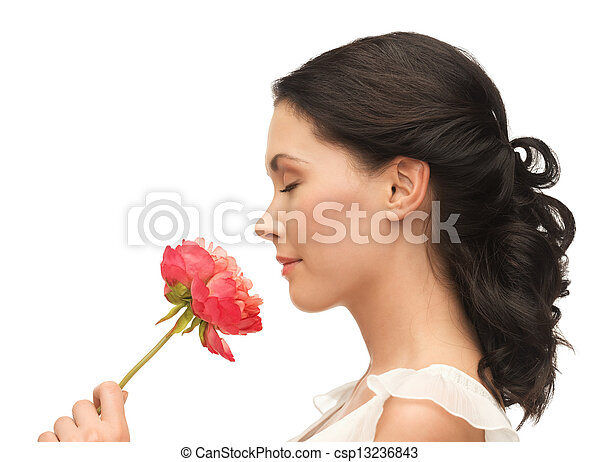 smiling woman smelling flower - csp13236843
