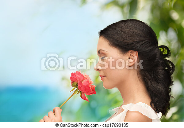 smiling woman smelling flower - csp17690135