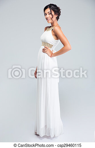 Smiling woman standing in fashion dress - csp29460115