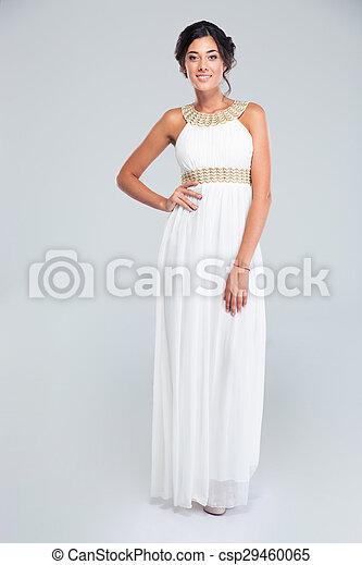 Smiling woman standing in trendy dress - csp29460065