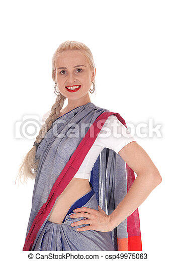 Smiling woman wearing an east Indian dress - csp49975063