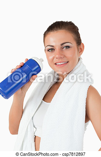 Smiling woman with her bottle after workout - csp7812897
