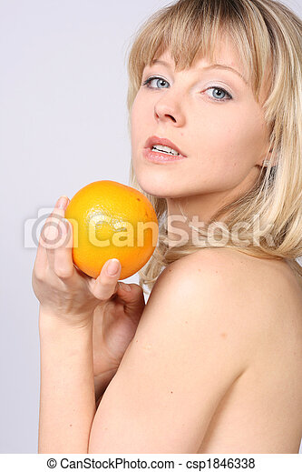 smiling woman with orange - csp1846338