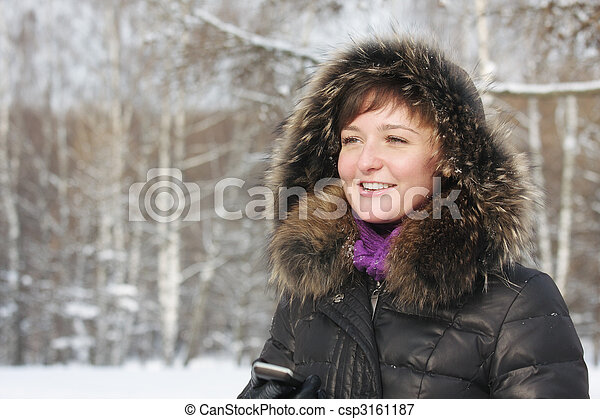 Smiling woman with phone in hand - csp3161187