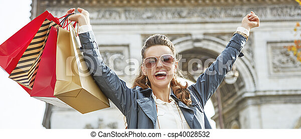 smiling woman with shopping bags in Paris, France rejoicing - csp40028532