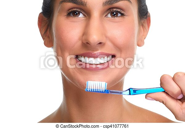 Smiling woman with toothbrush. - csp41077761